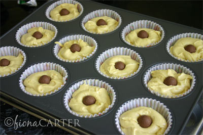 make your cupcake mixture place mixture into cupcake tins